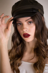 Close up portrait of a beautiful sexy brunette woman with red lips and bright makeup.