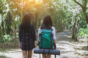 couple traveler woman friends with backpack ready to go to hiking travel walking in to forest. holiday adventure trekking and camping concept.