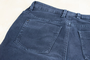 Denim shorts under magnification. Trouser zipper, belt loops and other small items in jeans.