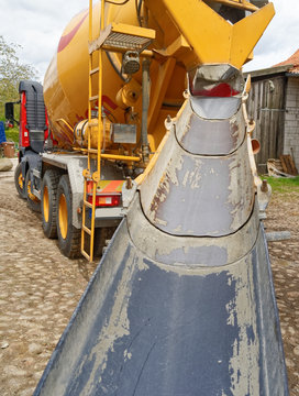 Direct view of the empty and clean ramp of a concrete mixer on a construction site