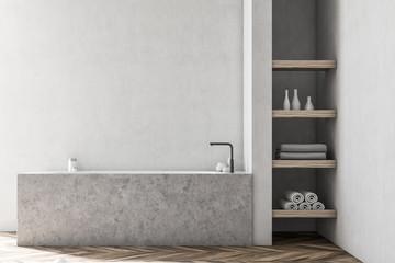 White bathroom interior, marble tub