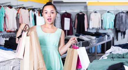 Woman is holding purchases