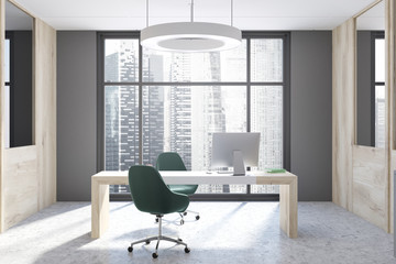 Gray and wooden CEO office interior