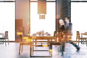 Loft restaurant interior, people