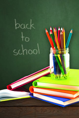 Books ,pen,pencil and office equipment on board background, education and back to school concept,Clipping path