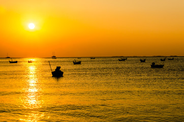 Blurred of silhouette boat on the ocean and sunset background