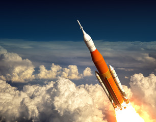 Fotobehang - American Space Launch System In The Clouds