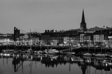 Panoramic view of a cityscape at night with illumination in Waterford, Ireland. Black and white