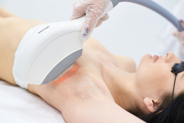 Laser hair removal. Medical procedure. Removing underarm hair. Bright skin