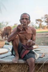 Elderly man was sitting smoke