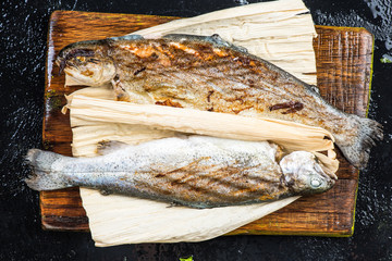 Grilled trout in horn husk