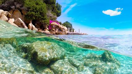 Split underwater view of Capriccioli beach coastline