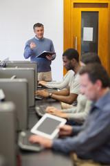 Teacher talking to his computer class