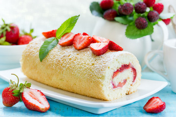 Homemade biscuit roll stuffed with strawberries
