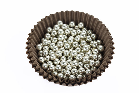 Silver sprinkle balls cake decoration isolated on white background
