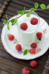 Yogurt with fresh berries on dark background
