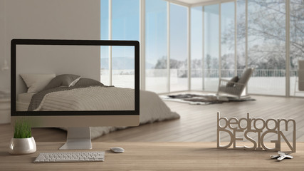 Architect designer project concept, wooden table with keys, 3D letters making the words bedroom design and desktop showing draft, blurred space in the background, interior design