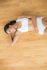 Content sporty brunette lying down