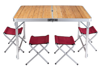 folding table for camping on a white background, stands in the unfolded state, next are folding chairs, four red chairs