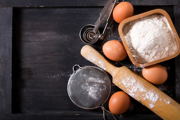 ingredients for baking : flour, eggs  and kitchen utensils for cooking