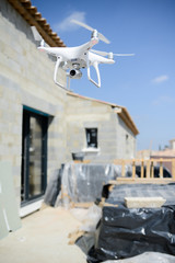 inspection drone flying for a aerial view of house construction site industry