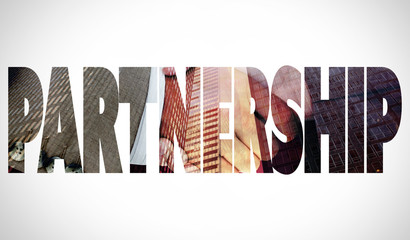 The word partnership and side view of business peoples hands shaking against low angle view of skyscrapers