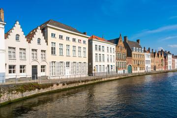 View of a canal and old historical buildings in Bruges, Belgium