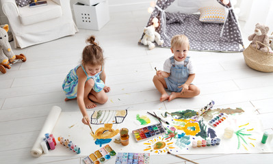 happy funny children paint with paint