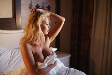 Portrait of an adult sexy woman with big natural breast. Blonde with blue eyes and beautiful hair