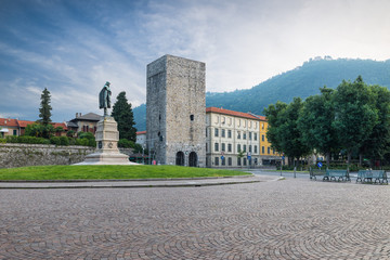 Como city, historic center, lake Como, Italy. Picturesque view, square Vittoria and medieval tower (12th century) called Porta Torre. Itinerary and travel destination in northern Italy