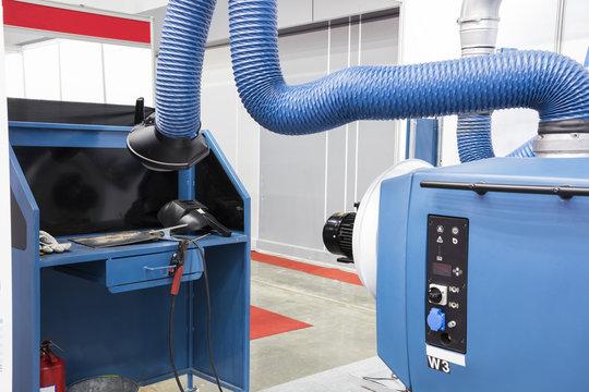 Blue Industrial welding equipment  workshop with welding fume and dust extractor. industrial equipment background