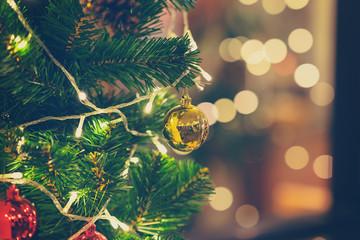 Closeup of christmas ball hanging from Christmas tree.