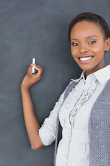 Black teacher looking at camera while smiling