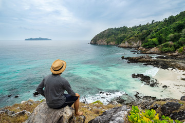 Young traveler looking beautiful seascape view at cock burn Island in Myanmar, Summer vacation and travel concept