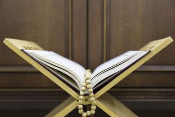 Holy book for Muslims. Koran and rosary on the lectern for Ramadan and three months.