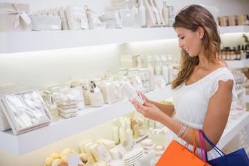 Smiling woman reading ingredients