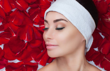 Portrait of a beautiful woman in a spa salon in front of a beauty treatment against the background...