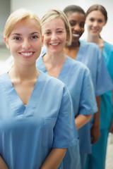 Smiling female nurses looking at camera