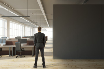 Businessman in modern office with copyspace