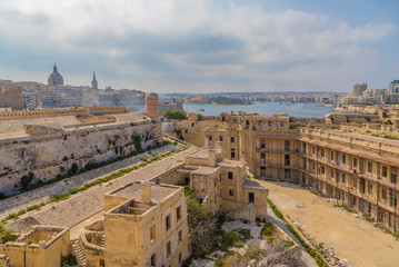 Valletta, Malta. View from within the fort of St. Elmo in the direction of Valletta (on the left) in the bay of Marsamxett and the city of Sliema (on the right)