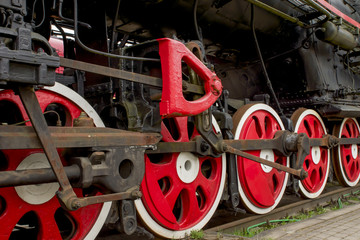 classic red wheels of a steam engine train