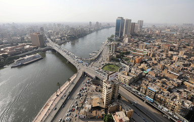 The 15th May Bridge, which spans the River Nile, and the surrounding buildings are seen in Cairo