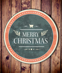 Banner and logo saying merry christmas against wooden planks background