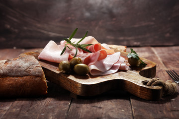 Sliced ham on wooden background. Fresh prosciutto. Pork ham sliced