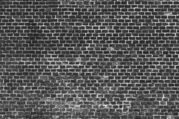 Old brick wall - empty facade, retro background, black-and-white picture
