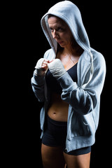Female fighter in hood with fighting stance