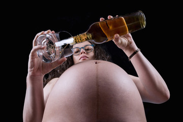 Subjective view of a pregnant woman drinking alcohol