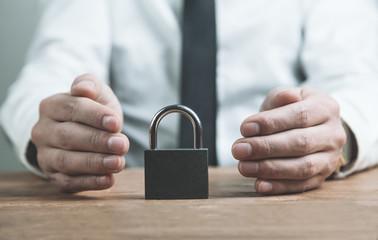 Businessman protect padlock. Security concept