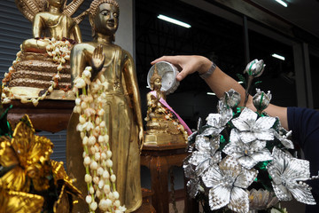 sprinkle water onto a Buddha in Songkran festival