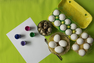 Easter background with white chicken Chicken and quail eggs decorative sisal. Close-up photo, macro.  Food concept